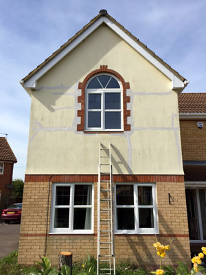outside render repaired and painted